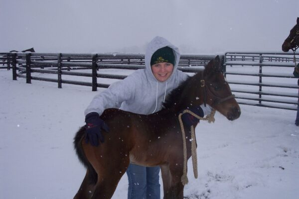 RACHEL WITH FOAL IN SNOW